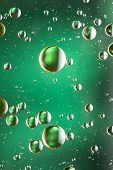 Vivid green and gold oil and water abstract