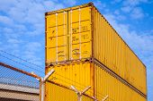 Yellow Metal Industrial Cargo Containers Are Stacked