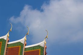foto of gable-roof  - the gable apex with small bell on the roof of temple - JPG