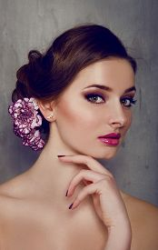 picture of carnations  - Beautiful woman with carnation flower in her hair with smokey eyes makeup - JPG