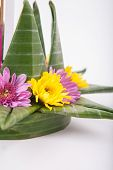 foto of floating  - Krathong the hand crafted floating candle made of floating part decorated with green leaves colorful flowers and many sorts of creative materials  - JPG