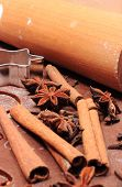 picture of christmas spices  - Spice for baking anise cinnamon cloves cookie cutters and rolling pin on dough for gingerbread concept for baking and christmas time - JPG