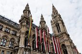 pic of gay symbol  - Vienna Town Hall with Gay Pride Flag symbol on historic building for tolerance and acceptance - JPG