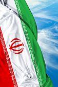stock photo of tehran  - Iranian waving flag on a beautiful day - JPG
