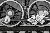 picture of locomotive  - big wheels a closeup of the vintage locomotive with the steam engine on railway tracks of black color - JPG