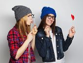 stock photo of two women taking cell phone  - two stylish sexy hipster girls best friends ready for party - JPG