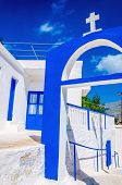 stock photo of greek  - A view of a Greek church with iconic blue colors on Greek island - JPG