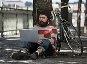 stock photo of moustache  - Handsome big moustache hipster man in the city with notebook - JPG