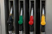 foto of gasoline station  - Color full gasoline pump guns at petrol station - JPG