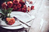 picture of wedding table decor  - Vintage table setting with glasses and cutlery on an old wooden board - JPG