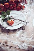 foto of wedding table decor  - Vintage table setting with glasses and cutlery on an old wooden board - JPG