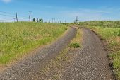 foto of barbed wire fence  - Dirt road and barbed wire fence on a hill Colfax Washington - JPG