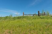 image of barbed wire fence  - Barbed wire fence on a hill Colfax Washington - JPG