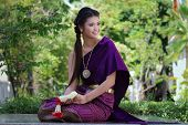 stock photo of national costume  - Thailand National Costume Asian woman wearing thai traditional dress - JPG