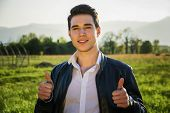 foto of grassland  - Handsome young man at countryside - JPG