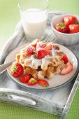 foto of icing  - belgian waffles with icing sugar and strawberry - JPG