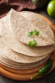 foto of whole-wheat  - whole wheat tortillas on wooden board and vegetables - JPG