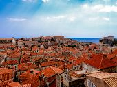 stock photo of red roof  - Red tile roofs in historic Dubrovnik Coratia with dramatic sky - JPG
