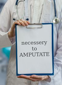 stock photo of amputation  - Amputation surgeon doctor gives advice to amputate - JPG