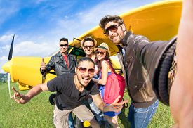 picture of ultralight  - Best friends taking selfie at aeroclub with ultra light airplane  - JPG