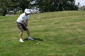 Lady Golfer Hits The Ball