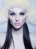 Portrait Of Attractive Girl With Furry Hat poster