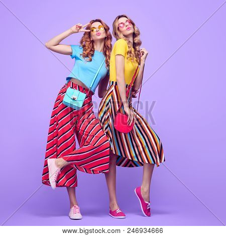 poster of Two Playful Sisters Twins With Kiss Face Expression. Young Beautiful Girls Having Fun In Studio On P