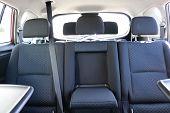 Car Interior. Rear Seats Of A Car Interior. Car Interior With Back Seats, Sunlight Flaring Through. poster