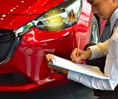 Career Man Saleman Business Inspection Writing On Notepad Or Book, Paper With Car Blurry Background. poster