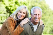 picture of elderly couple  - Happy senior couple relaxing in park - JPG