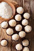Homemade Brazilian Sweets Beijinhos De Coco With Condensed Milk Close-up. Vertical Top View poster