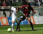 KAPOSVAR, HUNGARY - OCTOBER 15: Kornel Kulcsar (in white) in action a Hungarian National Championship soccer game - Kaposvar (white) vs Honved (red) on October 15, 2011 in Kaposvar, Hungary.