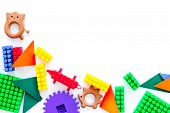 Educational Toys Farme. Plastic Lego Blocks And Clacks On White Background Top View. poster