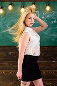 Teacher With Waving Long Blonde Hair Looks Sexy. Lady Strict Teacher On Dreamy Face Stands In Front  poster