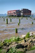 Astoria, Oregon Big Red Net Shed. The Historic, Weathered Net Shed Off The Shore Of The Columbia Riv poster