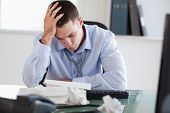 Close up of businessman getting frustrated with paperwork