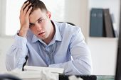 Young businessman overextended with his accounting
