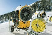 Yellow Snow Blower Machines Used For Preparing The Skiing In Dolomites. Snow Making Machine Close Up poster