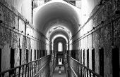 stock photo of cell block  - A cell block corridor at Eastern State Penitentiary in Philadelphia - JPG