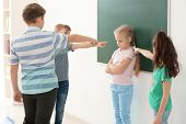Children bullying their classmate in school poster