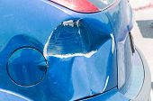 Blue Scratched Car With Damaged Paint In Crash Accident Or Parking Lot And Dented Damage Of Metal Bo poster