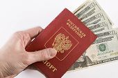 Russian Traveling Passport And Money In Hand.