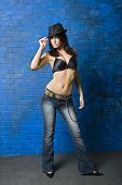 picture of pouty lips  - Full length view of sexy brunette in black bra and jeans - JPG
