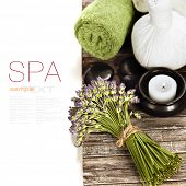 lavender spa (fresh lavender flowers,candlel, zen stones,  Herbal massage balls, towel) on a wooden