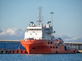 Platform Supply Vessel Anchored In Sea Port At Sunny Day. Front View Of Offshore Support Vessel poster
