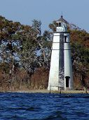 foto of katrina  - On our first boating trip after the wrath of Hurricaine Katrina we were delighted to see The Madisonville lighthouse still standing strong - JPG