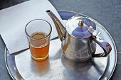 A Kettle Of Moroccan Mint Tea And A Glass