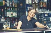 Happy Woman Bartender At Counter In Bar Or Coffee Shop. Bartender Girl At The Counter. Small Busines poster
