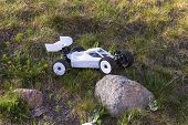 View Of Radio Controlled Model  Racing Car On Green Background. Toys With Remote Control. Free Time  poster