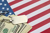 Army Identification Medallions And Dollar Bills On United States Flag. Military Pension, Salary In T poster